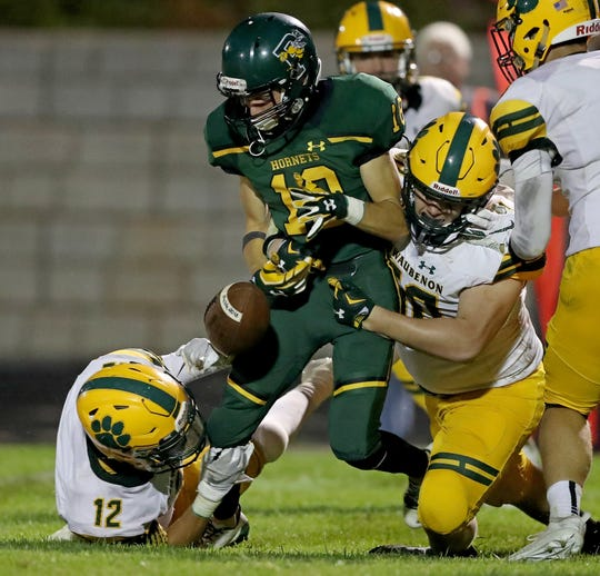 Preble Hornets wideout Ben Navarre has the ball stripped by Ashton Steinike against Ashwaubenon High School at Preble High School Thursday, August 16, 2018 in Green Bay, Wis.