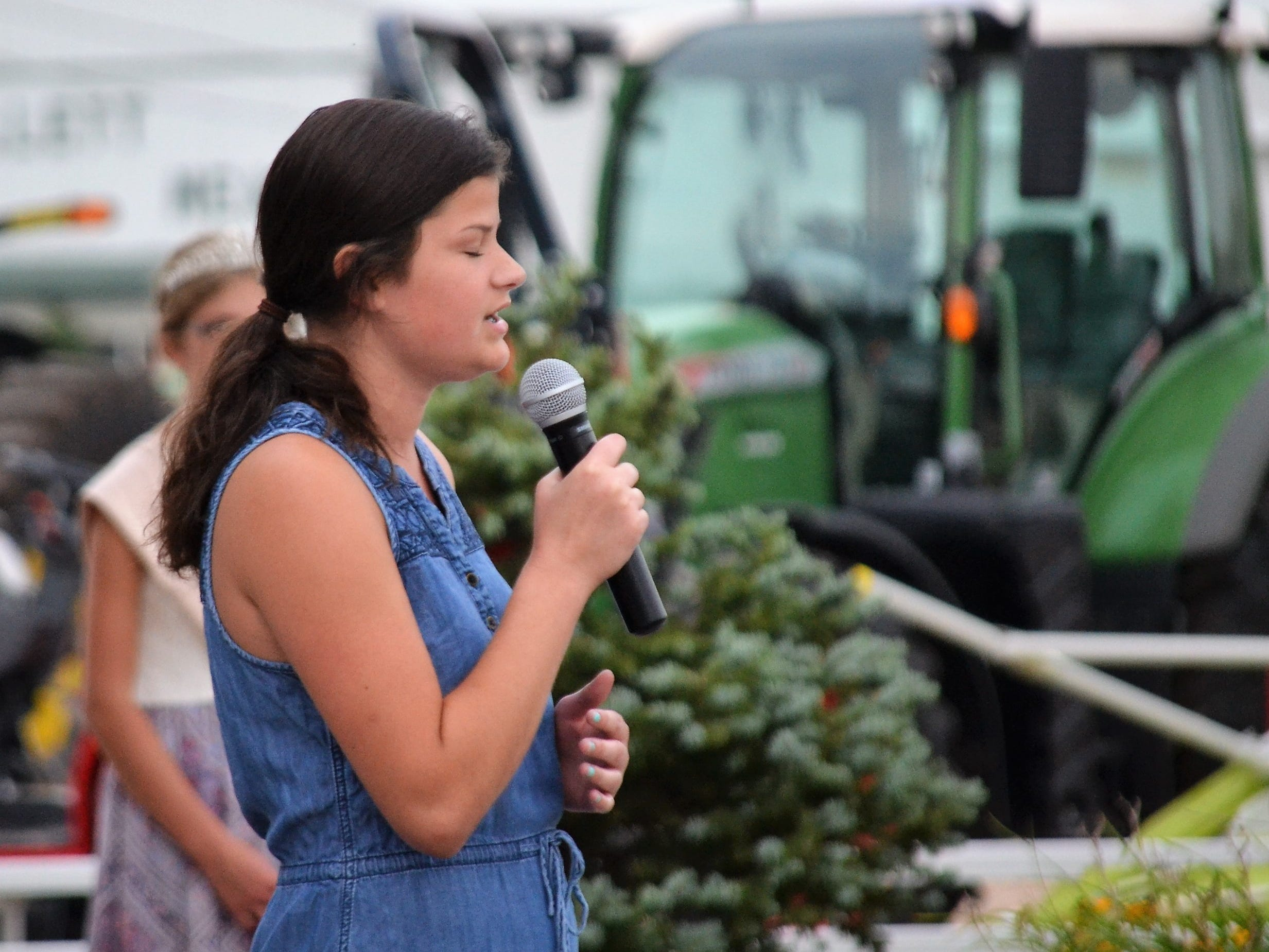 Peyton Buerman of Gillett sings America  the Beautiful to conclude the opening ceremonies of the Oconto County Fair in Gillett on Thursday, Aug. 16.