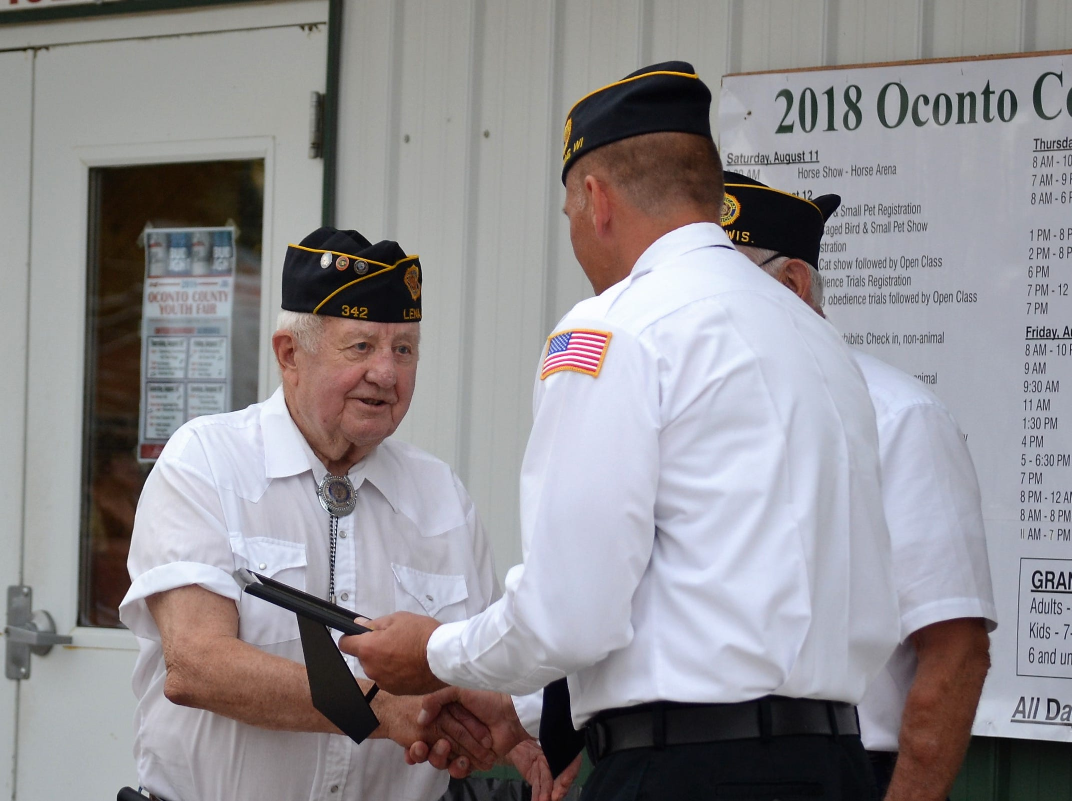 Elmer Ragen, left, shakes hands with Oconto County Veterans Service Officer Ron Christensen, after Ragen was recognized for his 30 years of service as president of the Oconto County United Veterans Council, during the opening ceremony at the Oconto County Fair on Thursday, Aug. 16.  Ragen started the group, made up of representatives from the local veterans groups across the county. The council meets at least twice a  year and coordinated the opening ceremony at the fair for most of its formation. Ragen is a former county veterans service officer and current member of the Oconto County Board, is from Little Suamico.