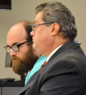 Bernard Poradek, left, and his attorney, Steven Johnson, listen as Judge Michael T. Judge hands down his sentence for homicide by negligent operation of a vehicle on Friday, Aug. 17, 2018 in Oconto County Circuit Court in Oconto.