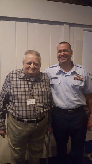 Ken Schmidtke, left, and Petty Officer First Class Harold Rissman pose during the Mariner Award Dinner Aug. 7, 2018.