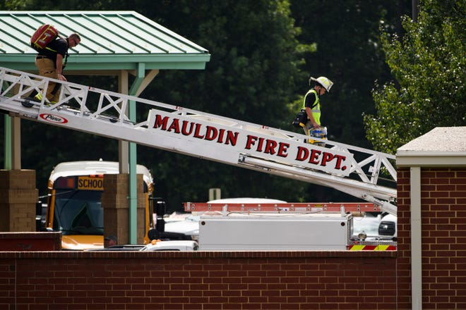 First responders at the Mauldin Middle School roof, where a man fell unconscious on Friday, Aug. 17, 2018.