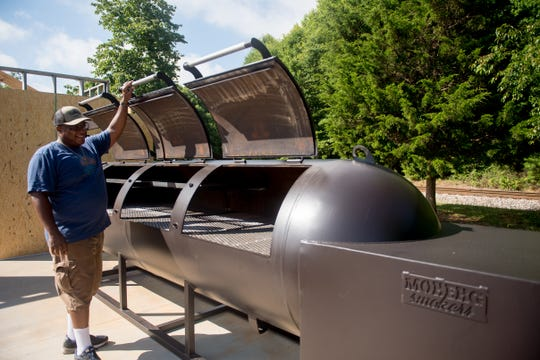 "Octavius ""Tay"" Nelson inspects his smokers at his forthcoming restaurant in Fountain Inn, Bobby's BBQ."