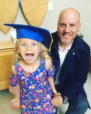 My husband and daughter at her preschool graduation.