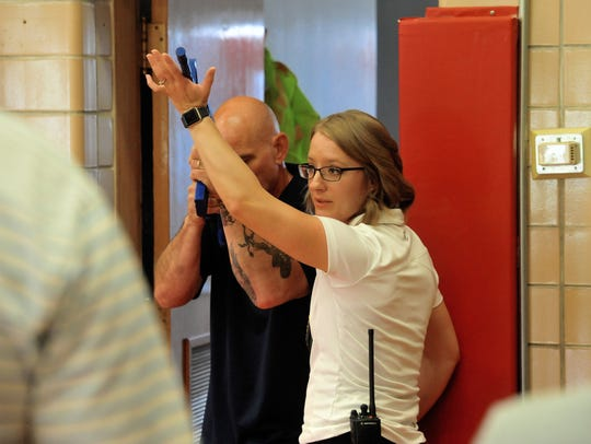 Christy Stevens, a teacher with Great Falls Public Schools, acts as the armed intruder during a demonstration by Great Falls Police Detective Katie Cunningham, Thursday during the Emergency Response to Armed Intruder training.