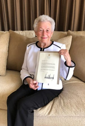 """World War II survivor Irene Ploke Sgambelluri holds a letter from President Donald Trump, thanking her for sharing her story of survival. Sgambelluri recieved the letter in the mail Thursday, Aug. 16, 2018, in response to her written testimony on wartime experiences, which she provided to the White House during her July trip to Arlington National Cemetery for a Liberation commemoration. In the letter, Trump acknowledged Sgambelluri's father, John Ploke, who was a Navy pharmacist's mate stationed on Guam when taken prisoner of war by the Japanese. """"The bravery you and your family exhibited in Guam during World War II is inspiring. It is important for Americans to hear the stories of courage and sacrifice from survivors like you,"""" Trump said in the letter. Sgambelluri said she was elated at receiving the letter."""