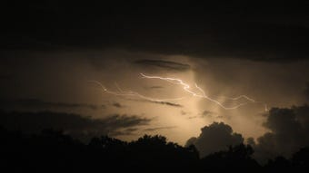 A video montage of bolts of lightning branching out above trees in northern Guam captured on the evening on Thursday, Aug. 16, 2018.