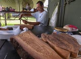 Chamoru Master Carver Robert Taitano teaches Dept. of Corrections clients woodcarving through a grant from the Guam Council on the Arts and Humanities Agency.