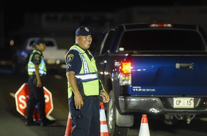 Guam Police Department officers conduct a DUI sobriety checkpoint on Marine Drive in Anigua, Aug. 17, 2018.