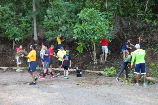 Veteran Volunteers clean and beautify the grounds of the Guam Veterans Cemetery in Piti on August 11.