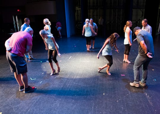 Participants dances the Waltz with the special men in their life during the Distinguished Young Women dress rehearsal at the at Preston Fine Arts Center Thursday, August 16, 2018.