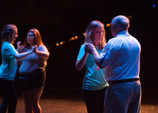 Ellie Payne dances the Waltz with grandfather James Stone during the Distinguished Young Women dress rehearsal at the at Preston Fine Arts Center Thursday, August 16, 2018.