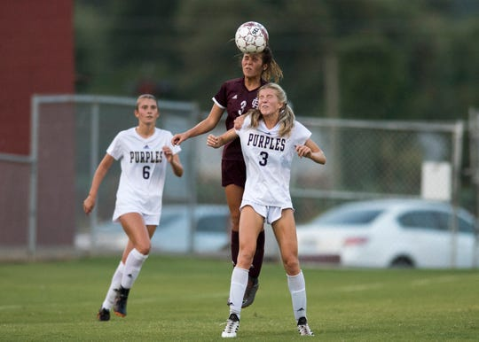 Henderson's Maggie Sauer (3) and Bowling Green's Emma Wilgruber (3) try to control a down field kick with a header during a game at Henderson County Thursday, August 16, 2018.