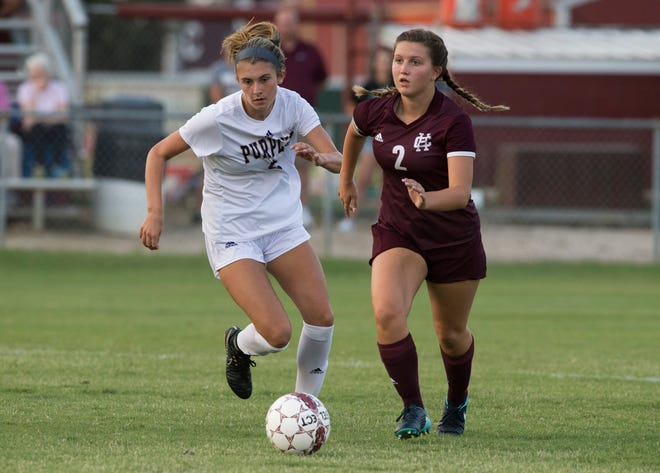 Bowling Green's Reilly Scheidegger (2) competes with HendersonÕs Madi Tompkins (2)  during a game at Henderson County Thursday, August 16, 2018.