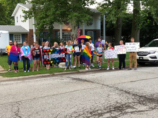 A group of Roncalli students, parents and alumni gathered outside of Roncalli High School Thursday, Aug. 16, 2018, before Roncalli's annual Back to School Night to support Shelly Fitzgerald, a Roncalli guidance counselor who was placed on paid administrative leave after school officials learned of her same-sex marriage.