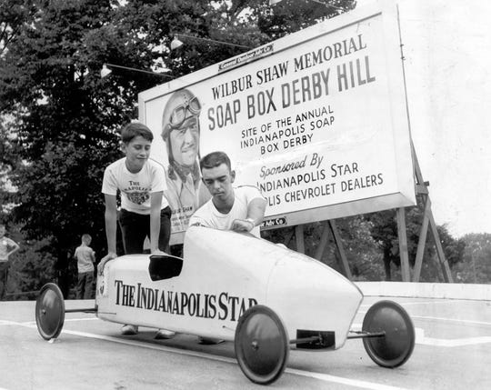 Gary Vaughn (right), 18-year-old winner of the 1955 Soap Box Derby, offers a building tip to Bob Amos, 14, 905 N. Ewing St., who will be competing in his fourth Star-Chevrolet Derby Saturday at Wilbur Shaw memorial Hill.  July 16, 1959