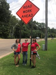 """Samantha Burnett, Lesley Daniel and Leah Daniel work at LD2 Consignment and wear their """"Make The Bypass Great Again"""" shirts at work on Friday."""