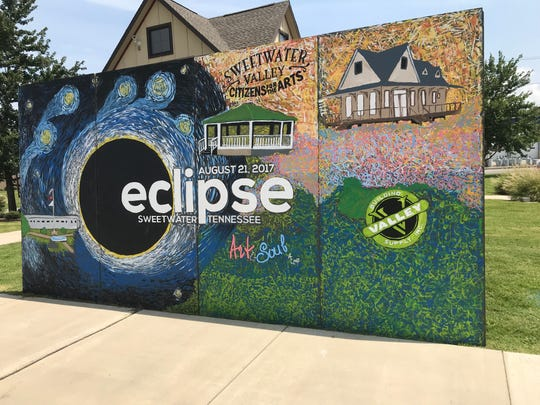 """A mural painted by a children's art camp last year is standing again for the Aug. 21, 2018 """"Reclipse"""" in Sweetwater, Tennessee. It's in front of the new depot visitor center, where the anniversary event will be held at 10 a.m. Tuesday."""