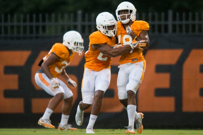 At right Tennessee defensive back Nigel Warrior (18) participates in a drill at preseason Vols football practice Thursday, Aug. 16, 2018.