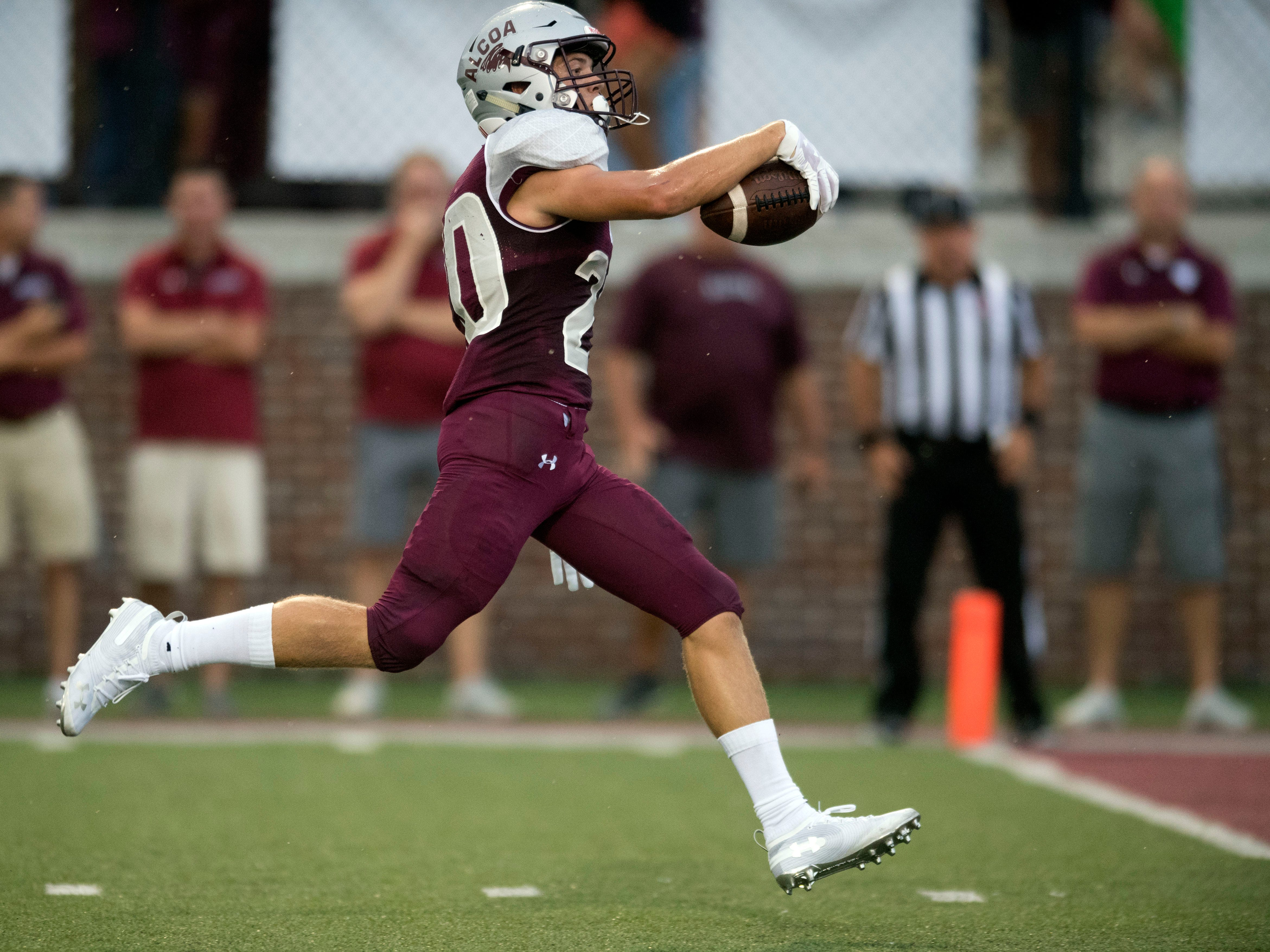 Alcoa's Tyler Boyd (20) runs the ball in for a touchdown in the football game against Grace Christian Academy on Thursday, August 16, 2018.