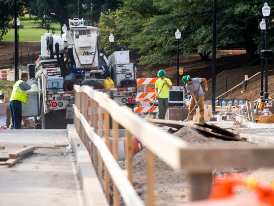 Work continues Volunteer Boulevard on the University of Tennessee's campus on Friday, August 17, 2018.