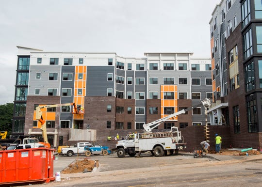 The 303 Flats apartment complex on West Blount Avenue just across the river from downtown has reached its full occupancy of nearly 450 residents.