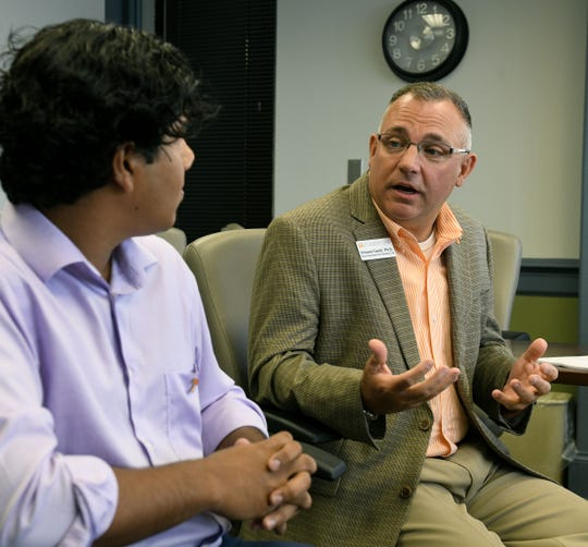 Vincent Carilli, right, vice chancellor for student life, and Ovi Kabir, student government president, address the report from the task force on alcohol policy at the University of Tennessee campus Friday, Aug. 17, 2018.