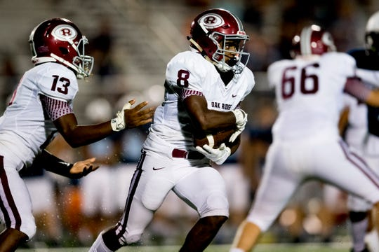Oak Ridge's Jordan Graham (8) takes the ball from Oak Ridge's Herbert Booker (13) during a football game between Hardin Valley and Oak Ridge at Hardin Valley Academy in Knoxville, Tennessee on Thursday, August 16, 2018.