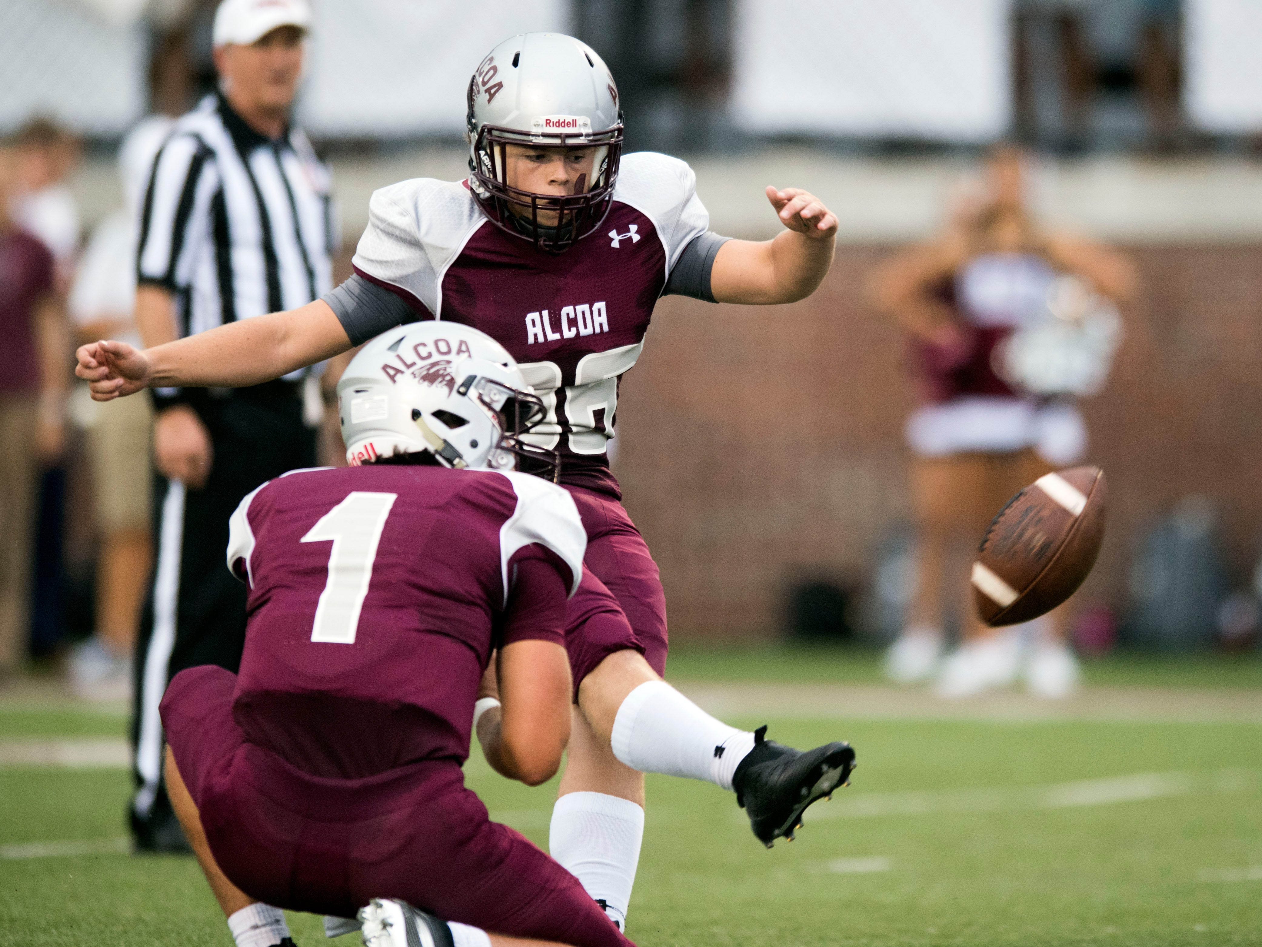 Alcoa's Zeke Rankin (96) makes the extra point with placeholder Walker Russell (1) during the football game against Grace Christian Academy on Thursday, August 16, 2018.