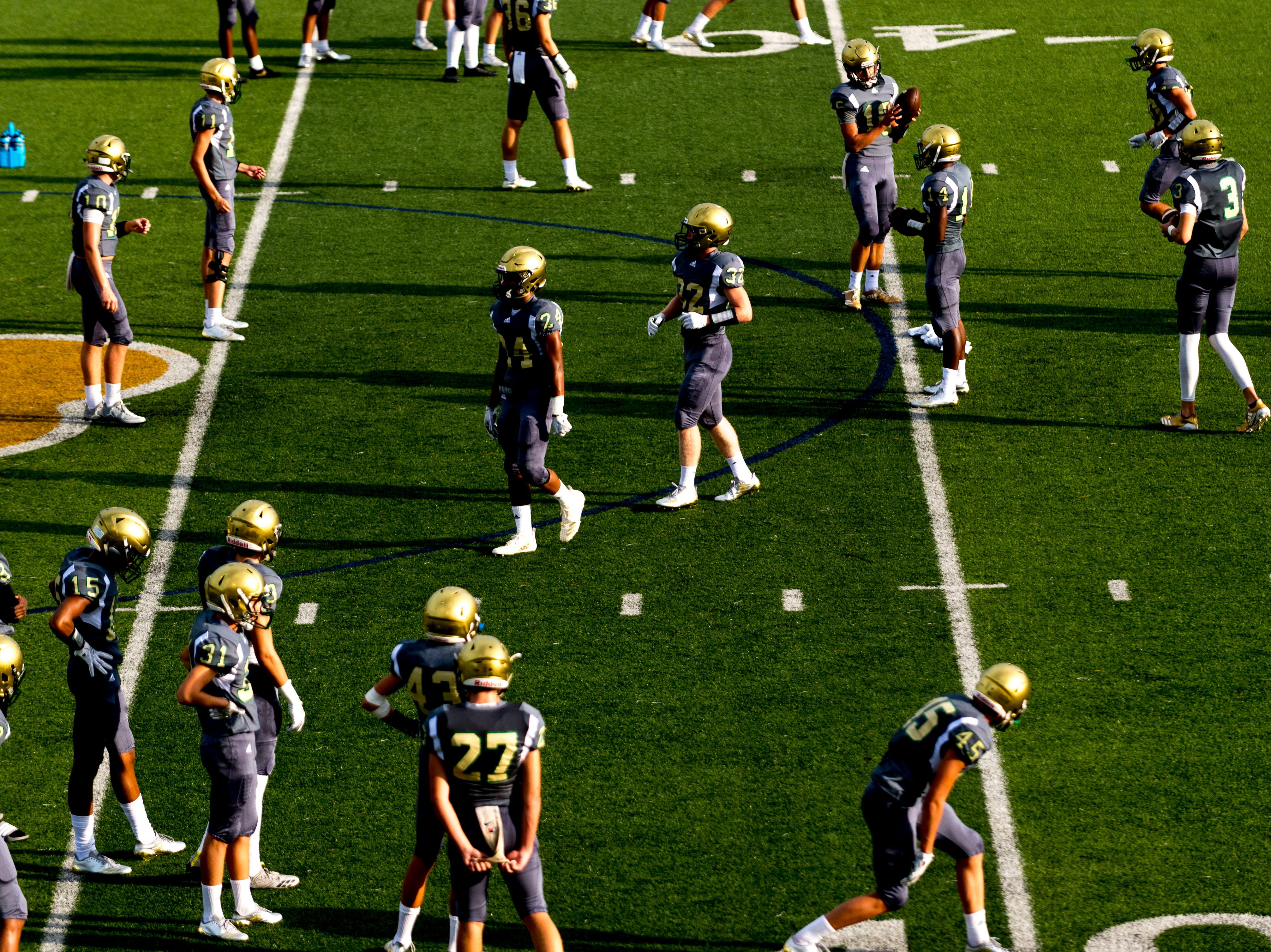 Catholic warms up during a football game between Maryville and Catholic at Catholic High School in Knoxville, Tennessee on Friday, August 17, 2018.