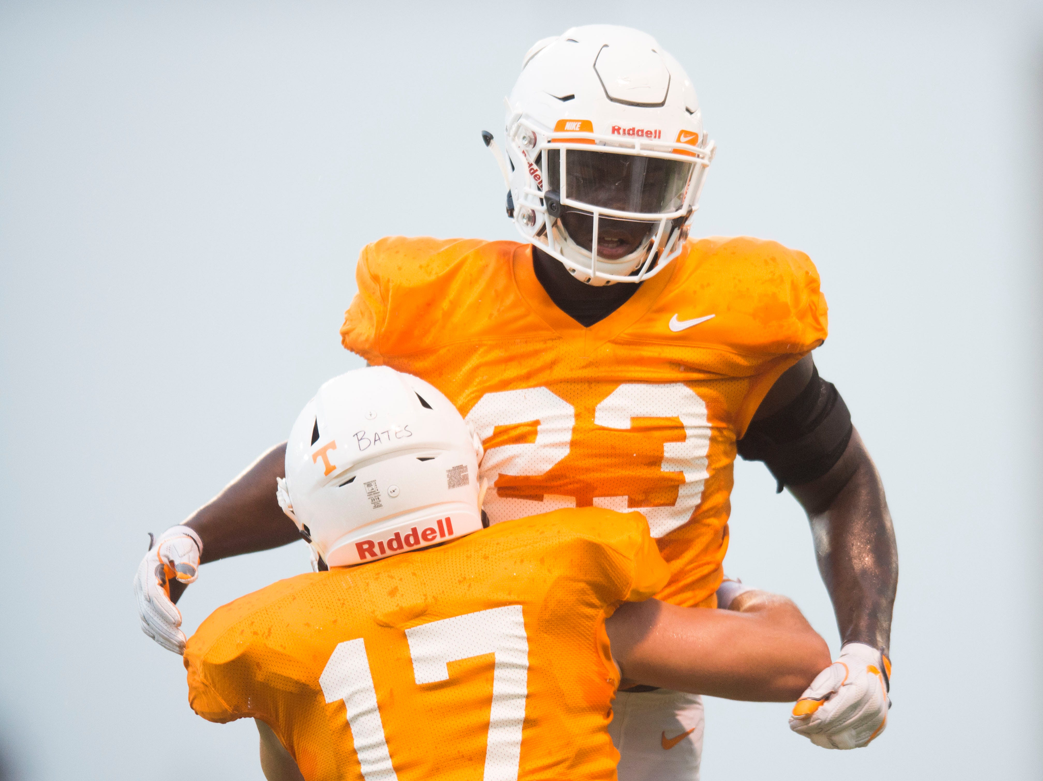 Tennessee linebacker Dillon Bates (17) and Tennessee linebacker Will Ignont (23) participate in a drill at preseason Vols football practice Thursday, Aug. 16, 2018.