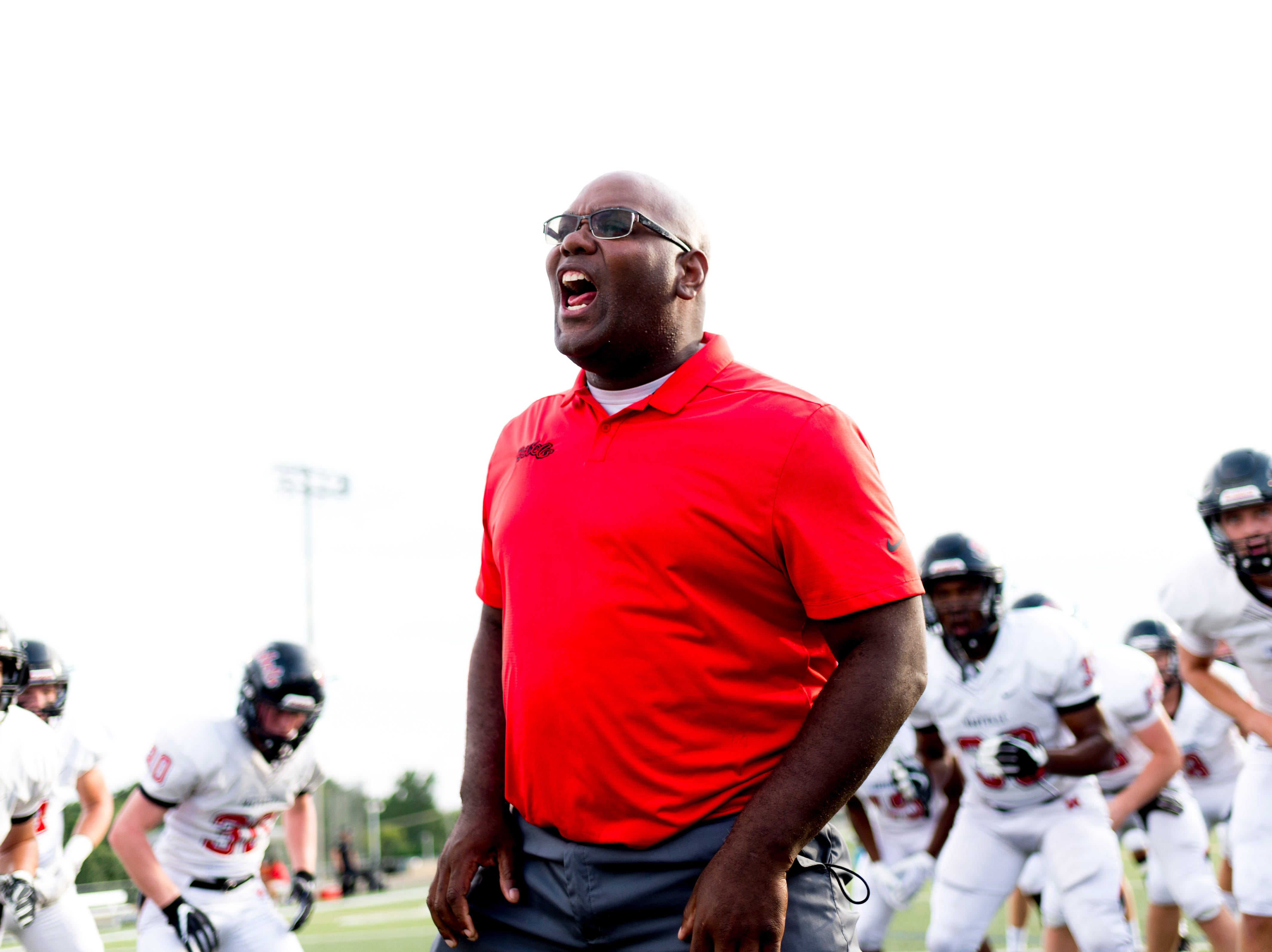 A Maryville coach pumps up the team during a pre-game huddle during a football game between Maryville and Catholic at Catholic High School in Knoxville, Tennessee on Friday, August 17, 2018.