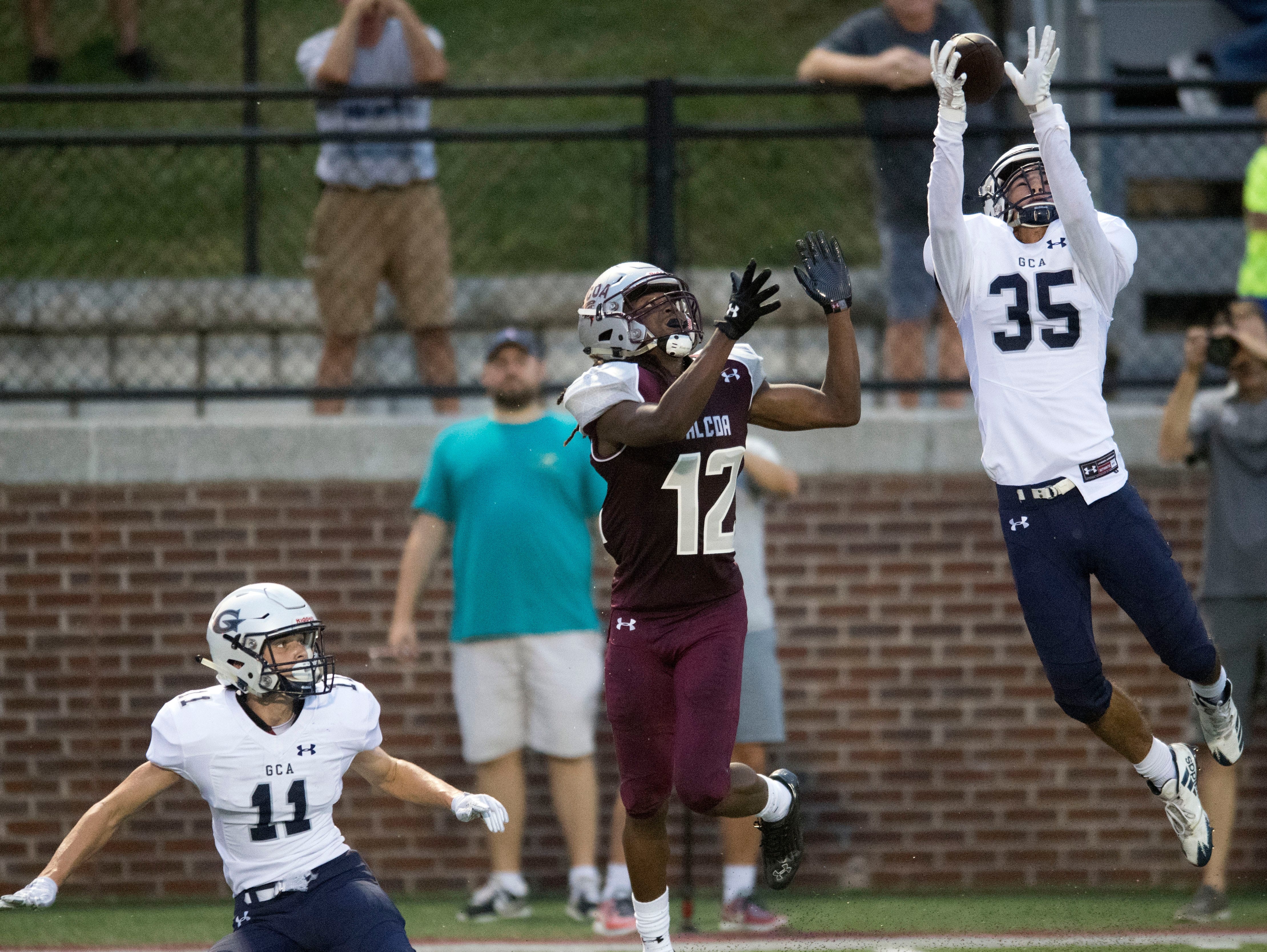 Grace Christian Academy's Ty Carter (35) breaks up a pass intended for Alcoa's Isiah Cox (12) during the football game  at Alcoa on Thursday, August 16, 2018.