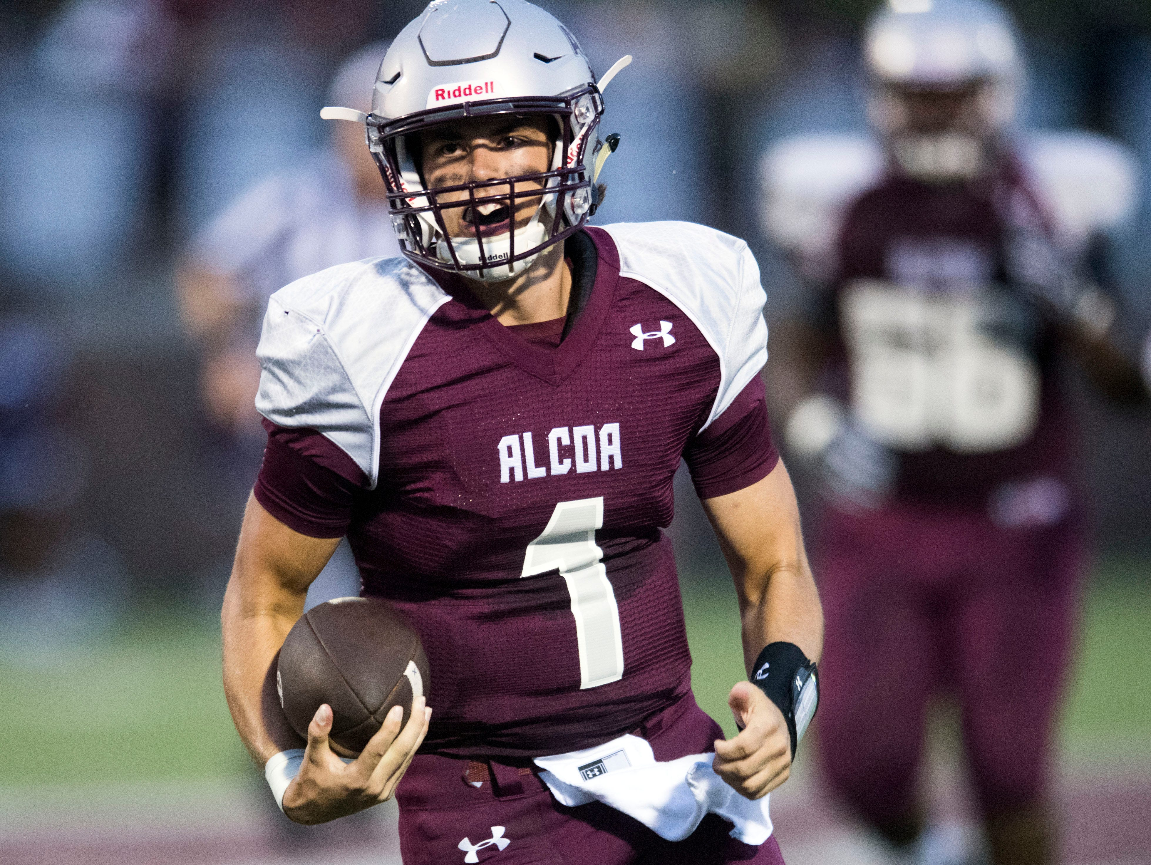 Alcoa quarterback Walker Russell (1) scrambles out of pocked during the football game against Grace Christian Academy on Thursday, August 16, 2018.