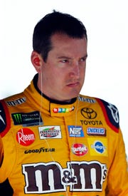 Kyle Busch walks through his pit during practice for a NASCAR Cup Series auto race, Friday, Aug. 17, 2018, in Bristol, Tenn. (AP Photo/Wade Payne)