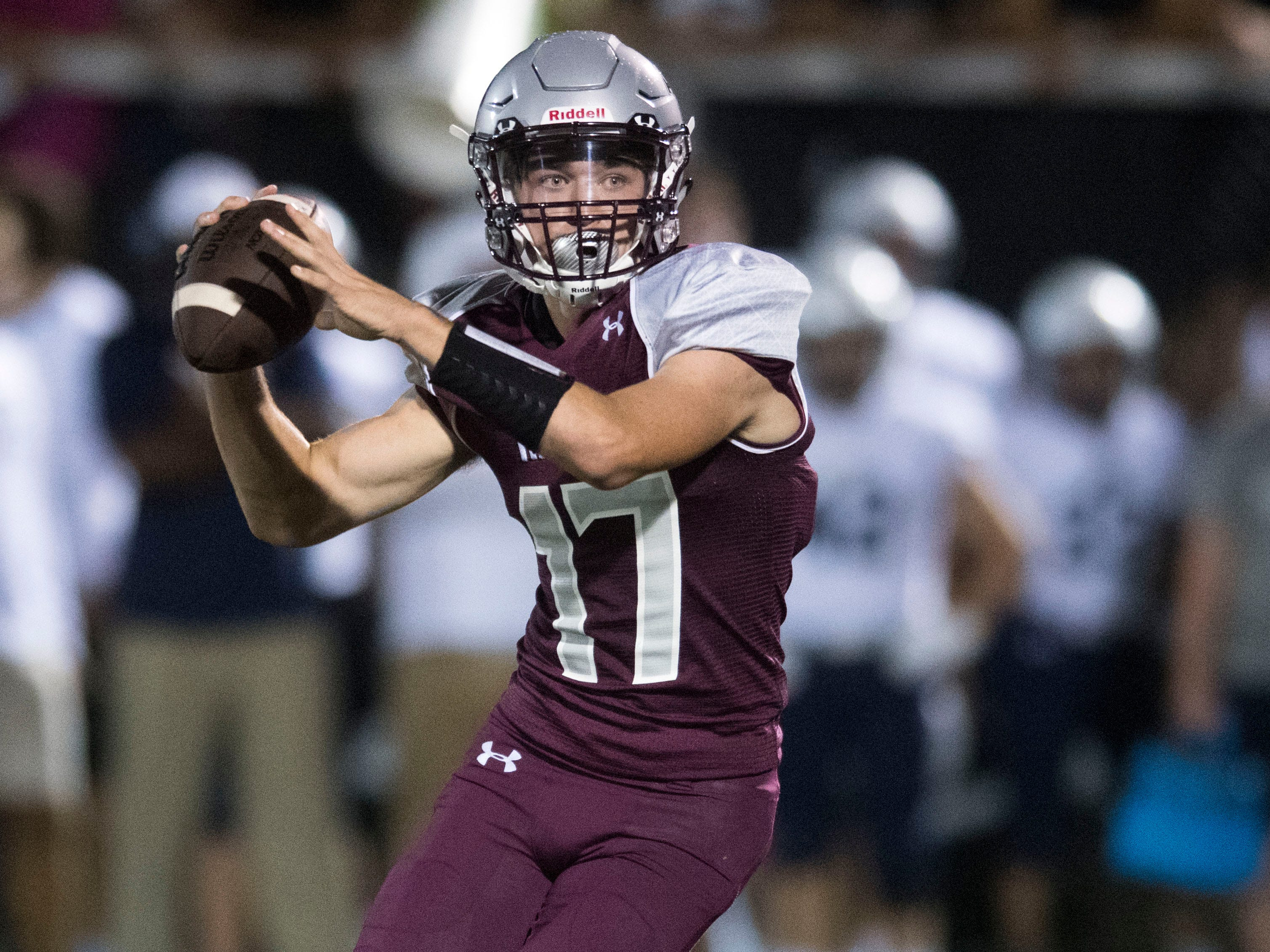 Alcoa quarterback Adam Mathews (17) sets to thrown during the football game against Grace Christian Academy on Thursday, August 16, 2018.