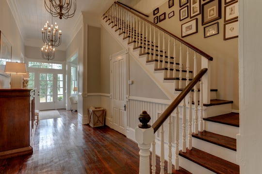 The antique staircase is a focal point in the home.