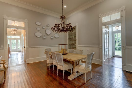 The formal dining room has lots of natural light.