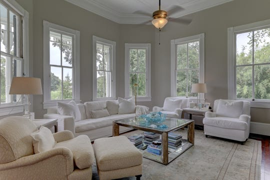 The living areas include huge windows overlooking the stunning property.