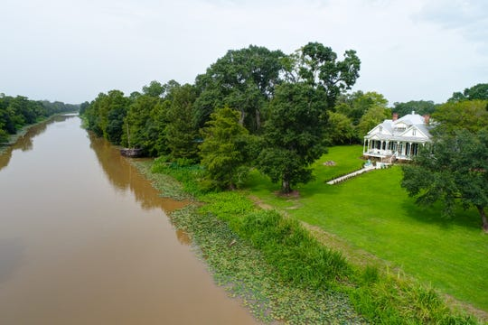 This home sits on several acres of bayou front property.