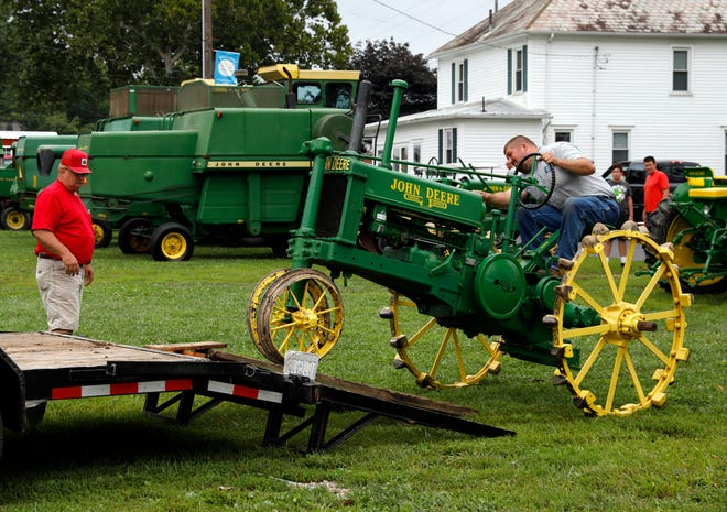 Ryan Young, from Rushville, back a 1937 John Deere model B tractor off a trailer Friday morning, Aug. 17, 2018, at the Fairfield County Fairgrounds in Lancaster. Young was showing six tractors at the Fairfield County Antique Tractor Club's annual show.