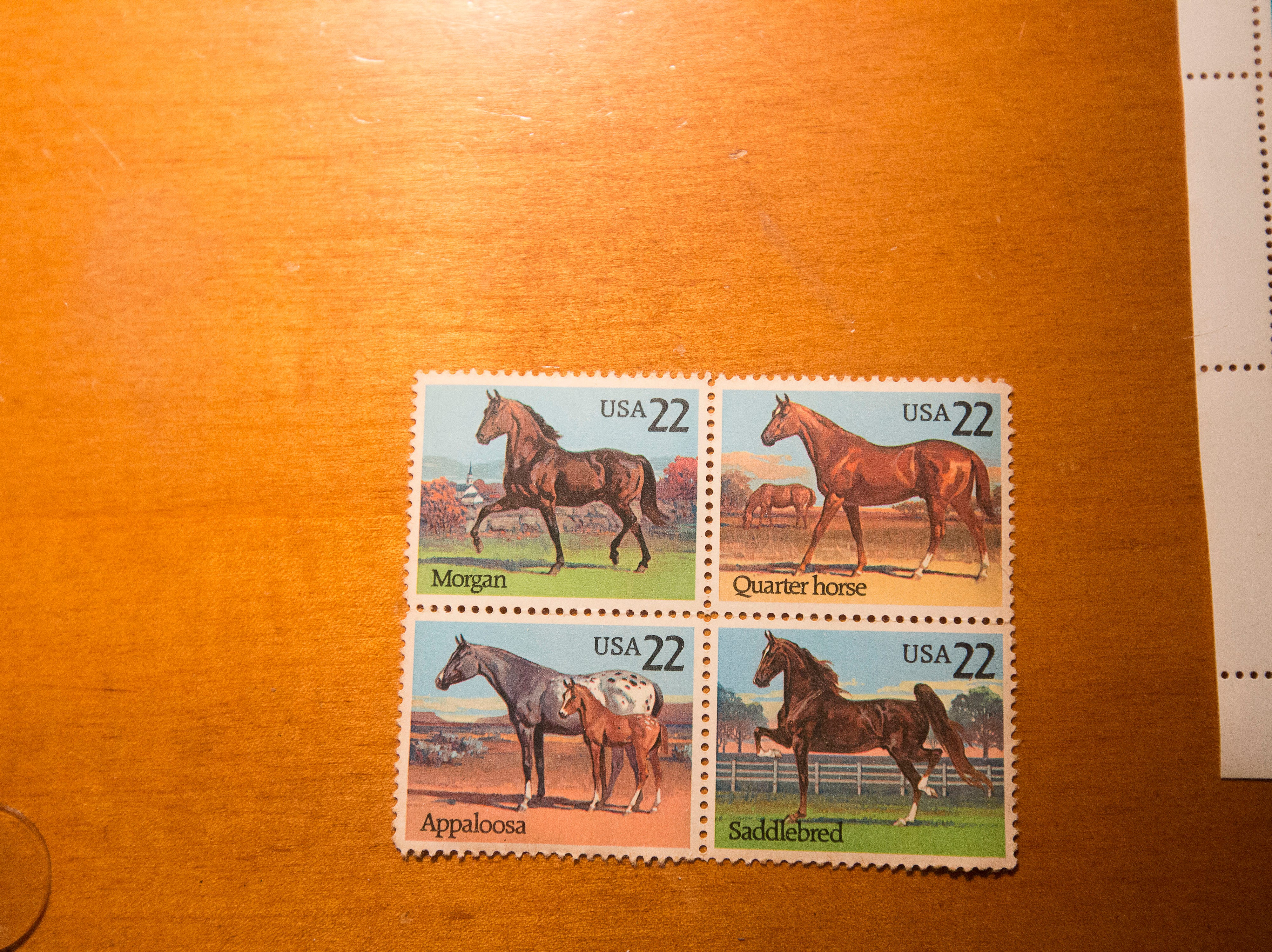 Stamps on the desk in the third floor apartment at historic Cherokee Triangle home in Louisville, KY.