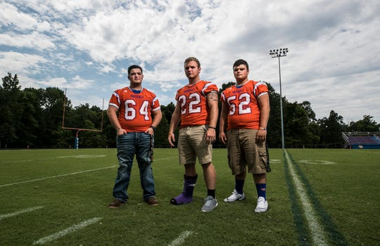 "Football players, from left, Gage Smock, Devon Evans and Dalton Keeling all were injured in the January 2018 Marshall County High School shooting. ""Some people have reached to me and I've talked to them,"" said Keeling. But for Keeling the season's first football game is a chance for him to ""release a lot of emotions and anger over since the 23rd. Seeing (the shooter) do that to us and we did nothing to them, there's a lot of anger built up."""