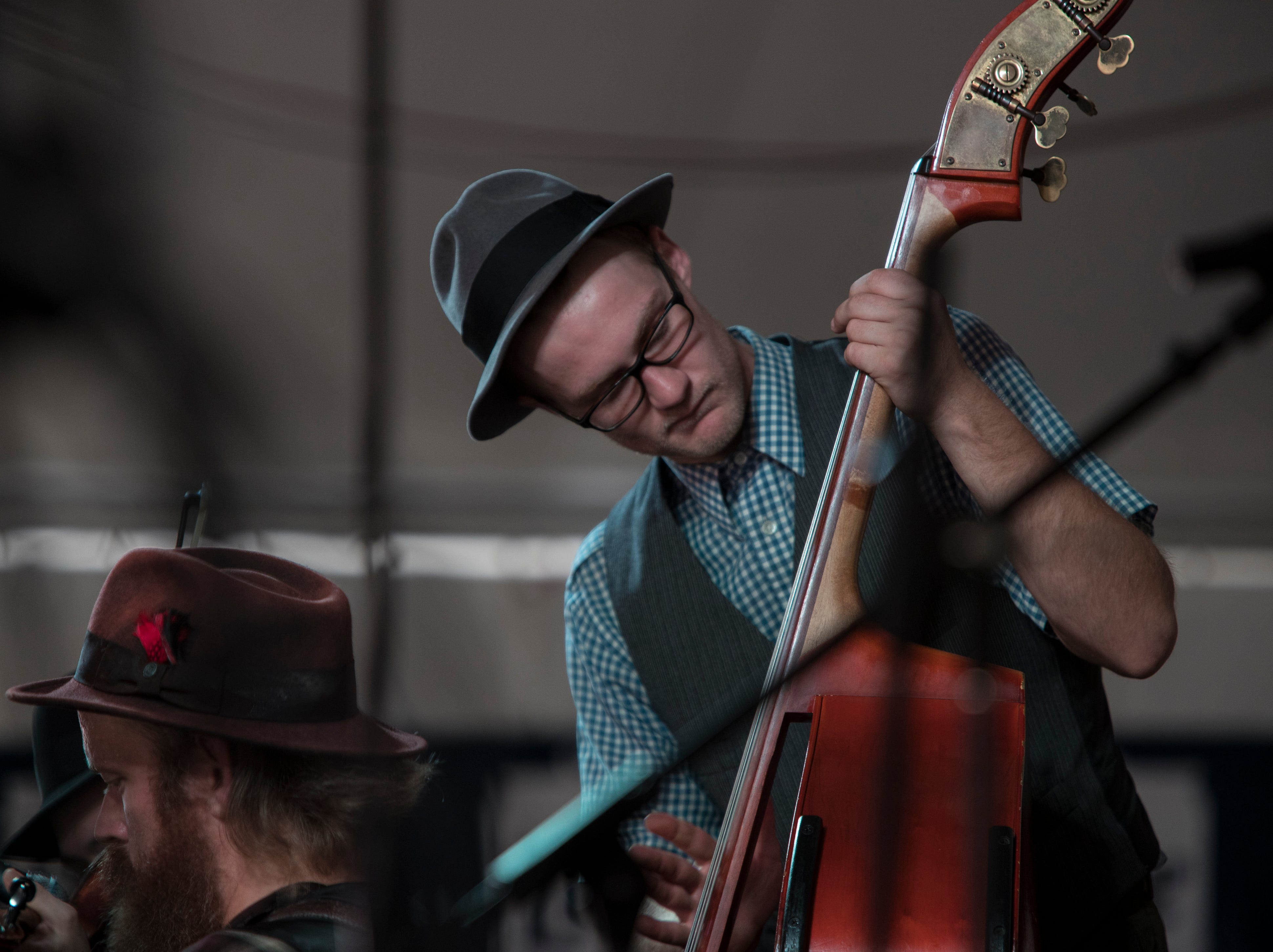 Leroy Jones of the Whiskey Bent Valley Boys slaps his bass during a performance at the Kentucky State Fair. Aug. 17, 2018.