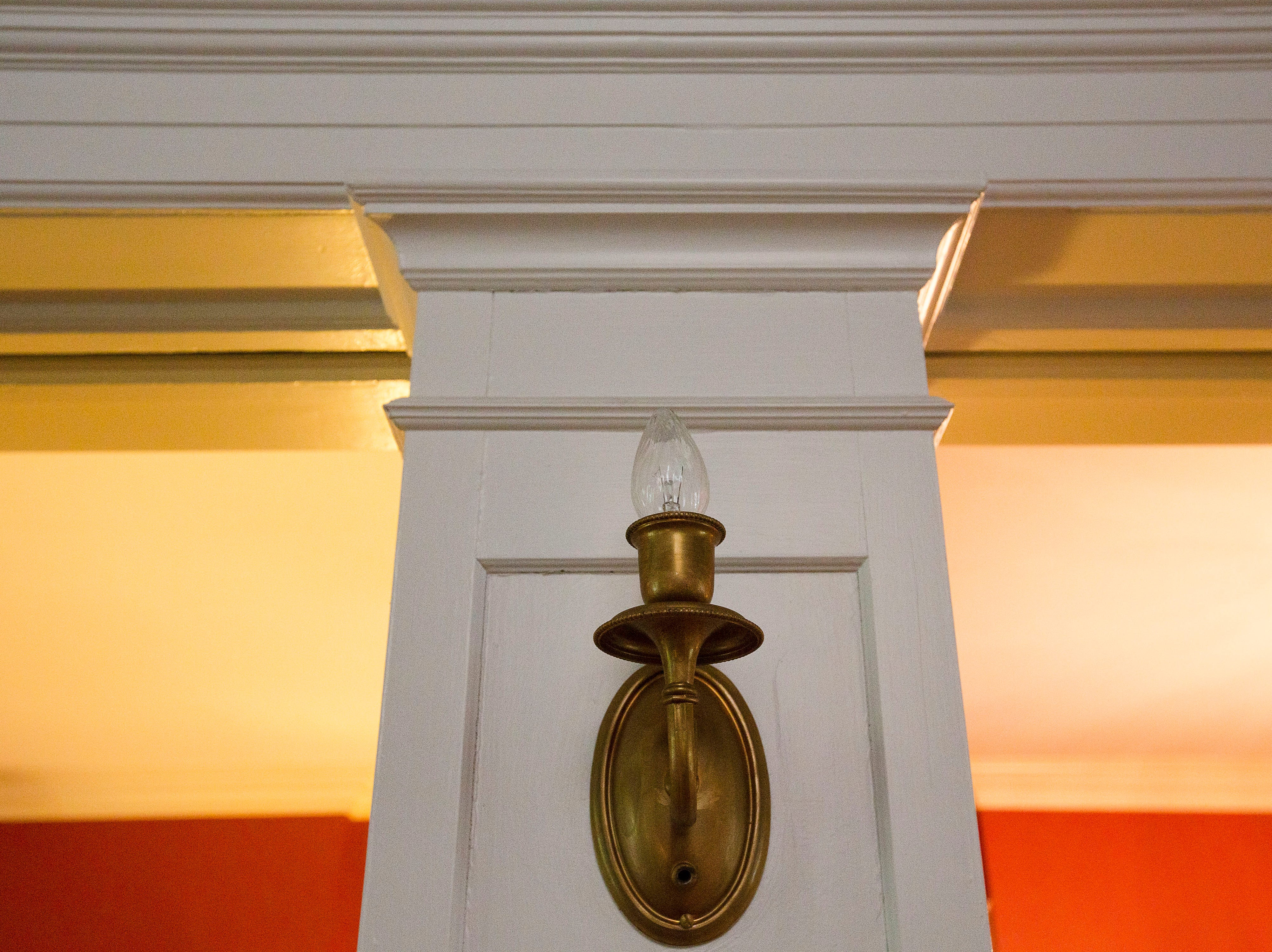 Detail of a sconce in this victorian home in historic Cherokee Triangle  in Louisville, KY.