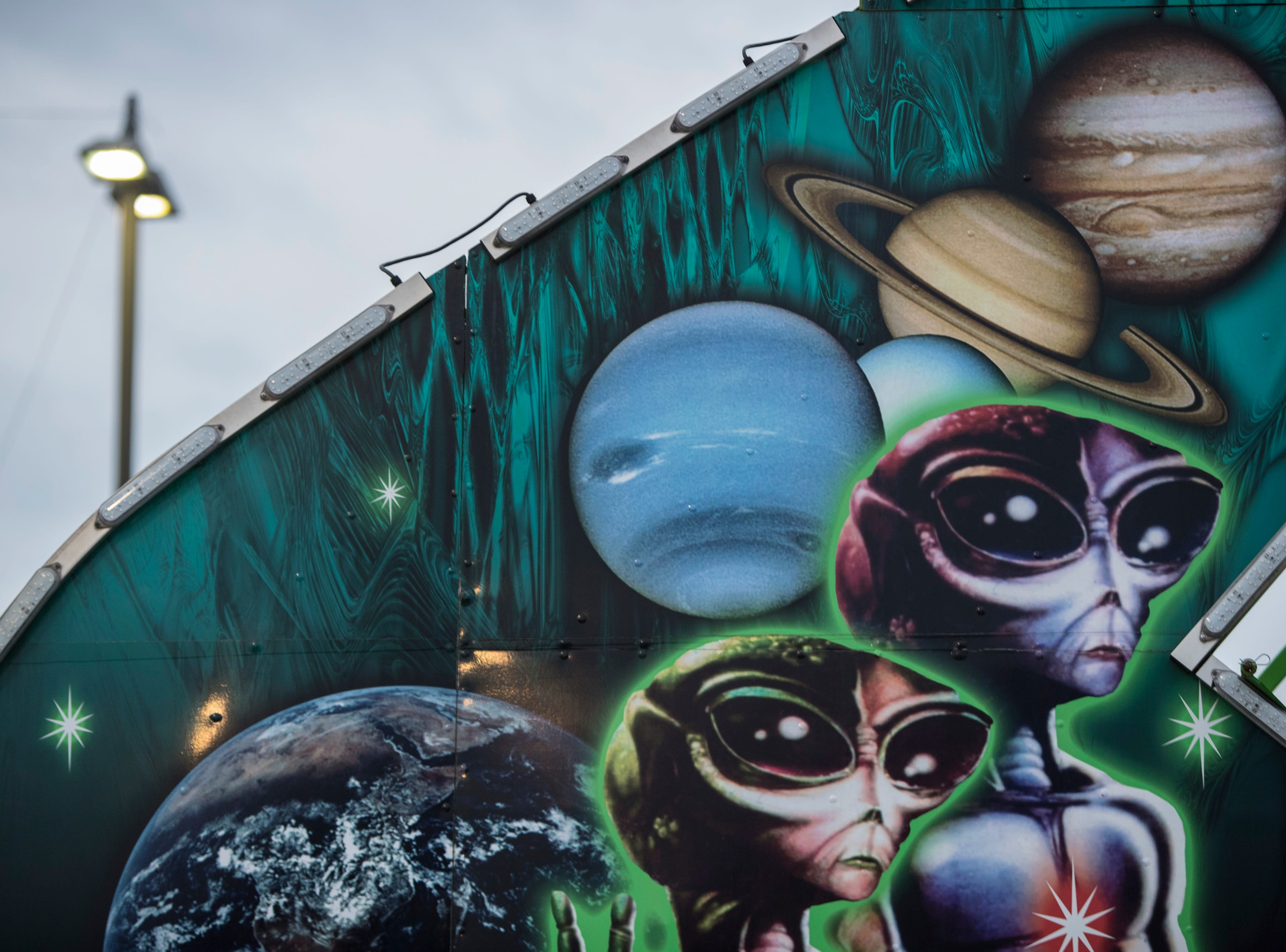 Space aliens graced the front of a midway ride at the Kentucky State Fair. Aug. 17, 2018.