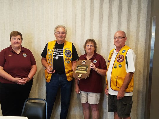 The Manitowoc Lions Club awarded its 2018 Melvin Jones Fellowship Award during its August meeting at Time Out Sports Bar and Grill. Pictured from left: Roxanne Staveness, committee member; Roger Sisel, recipient of the 2018 Melvin Jones Fellowship Award; JoAnne Bertsche, committee member; and Al Kanugh, committee chairman.