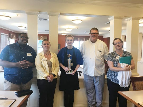 Jacob Mills, culinary services worker at The Court at Felician Village, has been named the Service Excellence Star Award recipient for July at the facility. Pictured from left: Xaviar Gilcrest, culinary services supervisor; Dani Schmidt, culinary services manager; Jacob Mills, STAR winner; Michael Collins, executive chef; and Ann Heimes, culinary services supervisor.
