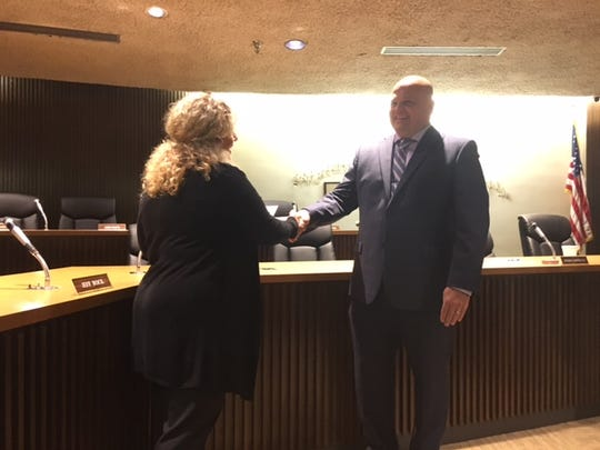 Mansfield Safety-Service Director Lori Cope congratulates Scott Kotterman Friday. Kotterman, 47, is the newest Mansfield police officer to be sworn in.
