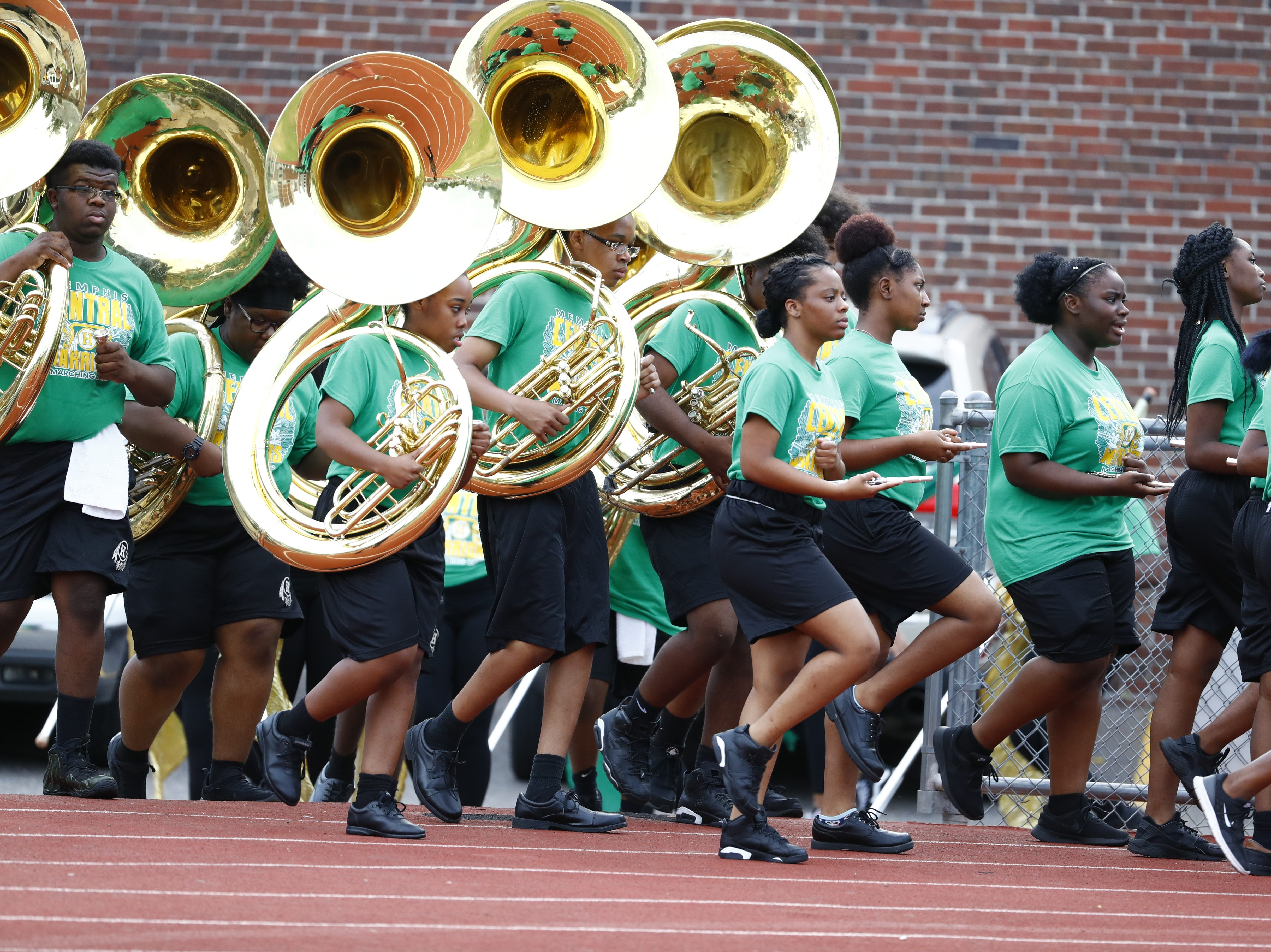 The Central band files into the stadium prior to Friday's season-opening football game against Melrose on Aug. 17, 2018.